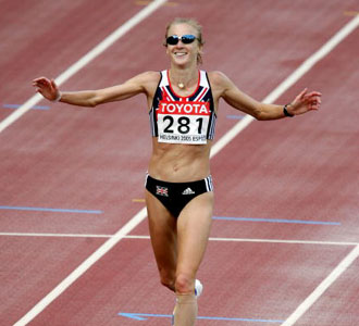 HELSINKI, FINLAND - AUGUST 14:  Paula Radcliffe of Great Britain celebrates as she crosses the finish line during the women's marathon at the 10th IAAF World Athletics Championships on August 14, 2005 in Helsinki, Finland. Radcliffe won gold, Catherine Ndereba of Kenya won silver and Constantina Tomescu of Romania won bronze.  (Photo by Ian Walton/Getty Images)