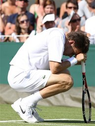 Nicolas Mahut of France takes a break, during his men's singles match against John Isner of the US, at the All England Lawn Tennis Championships at Wimbledon, Wednesday, June 23, 2010. (AP Photo/Alastair Grant)